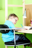Homework. 5 years old boy doing his homework - education royalty free stock photos