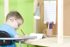 Homework. 5 years old boy doing his homework - education stock photo