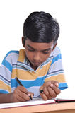 Homework. Young child doing his home work on white background - clipping path included Stock Photography