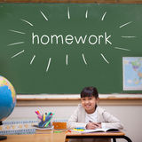 Homework against cute pupil sitting at desk Royalty Free Stock Photos