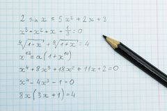 Homework on arithmetic. Formulas in the notebook stock photos
