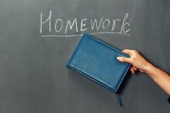 Homework on a blackboard Stock Photo