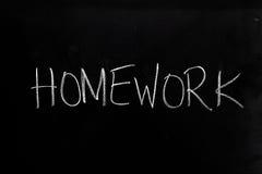 Homework on Blackboard. Handwritten chalk text Homework on the blackboard stock photography