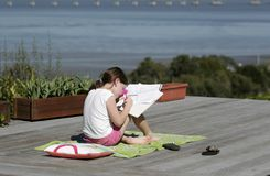 Homework California. A young girl does her homework in the sunshine Royalty Free Stock Photos