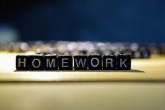 HOMEWORK concept wooden blocks on the table. stock photography