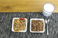 Homework diet breakfast, oatmeal with nuts and milk Royalty Free Stock Photo