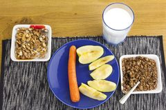 Homework diet breakfast, oatmeal with nuts and milk Royalty Free Stock Images