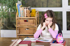 Homework. Girl is bored and conceived over her homework Stock Photo