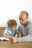 Homework with help of father Royalty Free Stock Photo
