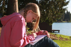 Homework by the lake Royalty Free Stock Image
