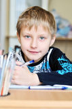 Homework of left-handed boy Stock Photos