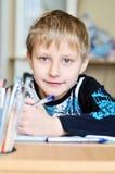 Homework of left-handed boy Stock Photos