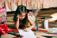 Back to school. Little girl paint picture for school Royalty Free Stock Photography