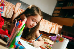 Back to school. Little girl paint picture for school Royalty Free Stock Photo