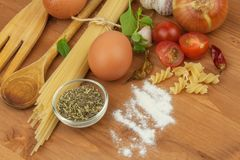 Homework pasta foods. Ingredients for cooking, spread out on the kitchen table. Traditional Italian food Royalty Free Stock Photo