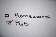 Homework or pub. This is for people /students who prefer to go out to a pub instead of doing their homework stock photos