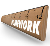 Homework Ruler Assignment Lesson Project for School. The word Homework on a wooden ruler symbolizing a lesson or assignment for school or educational training Royalty Free Stock Photography