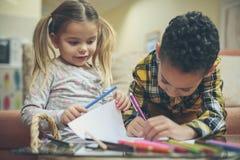 Homework in two is better. Children stock photo