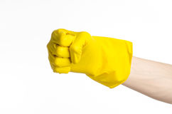 Homework, washing and cleaning of the theme: man's hand holding a yellow and wears rubber gloves for cleaning isolated on white ba Royalty Free Stock Photo