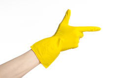 Homework, washing and cleaning of the theme: man's hand holding a yellow and wears rubber gloves for cleaning isolated on white ba. Ckground Stock Image