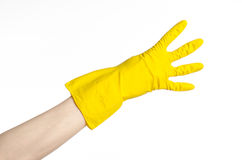 Homework, washing and cleaning of the theme: man's hand holding a yellow and wears rubber gloves for cleaning isolated on white ba Stock Photography