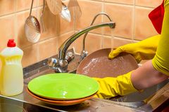 homework washing dishes - close-up hands with plates stock image