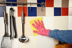 Homework -  woman Cleaning  the kitchen.  Royalty Free Stock Photography