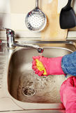 Homework -  woman Cleaning  the kitchen.  Stock Image