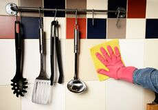 Homework -  woman Cleaning  the kitchen Stock Photography