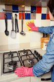 Homework -  woman Cleaning  the kitchen Stock Images