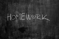 Homework written in chalk on blackboard Royalty Free Stock Photography