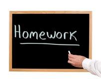 Homework. Is written in chalk on a chalkboard Stock Photo