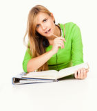 Homework, young student girl writting in the folder Royalty Free Stock Photos