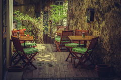 Homey outdoor cafe terrace Royalty Free Stock Photo