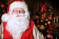 Homey santa. Santa Claus standing at home with gifts, dressed in his home clothes. Christmas. Decoration Stock Image