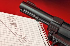 Homicide. Close-up of a notepad with word 'homicide' and gun on red background with selective focus stock images