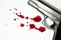 Homicide. Hand gun and blood splatter. Murder / Homicide Scene royalty free stock photos