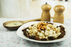 Hominy and toasted corn nuts mote con chicharron. Hominy and toasted corn nuts with pork skin on a plate traditional ecuadorian food selective focus Royalty Free Stock Images