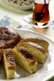 Hommade sweet bread with hot Turkish tea Royalty Free Stock Photos