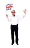 Homme âgé élégant célébrant la réussite Image libre de droits