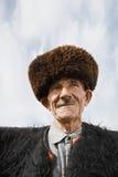 Homme âgé dans le manteau de feutre Photo libre de droits