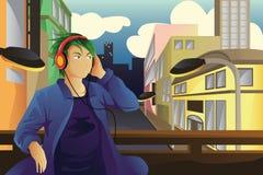 Homme écoutant la musique Photo libre de droits