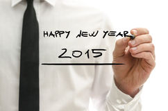 Homme écrivant la bonne année 2015 Image stock