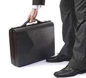 Homme élégant d'affaires dans la serviette de fixation de procès Photographie stock