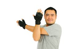 Homme étirant le muscle Photographie stock libre de droits