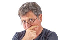 Homme étonné avec des verres d'oeil Images stock