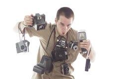 Homme étonné prenant des photos photographie stock libre de droits