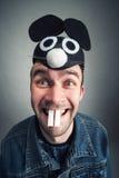 Homme étrange avec des oreilles de souris Photographie stock