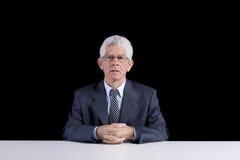 Homme aîné au bureau Images libres de droits