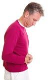 Homme aîné avec douleur dans l'estomac Photographie stock